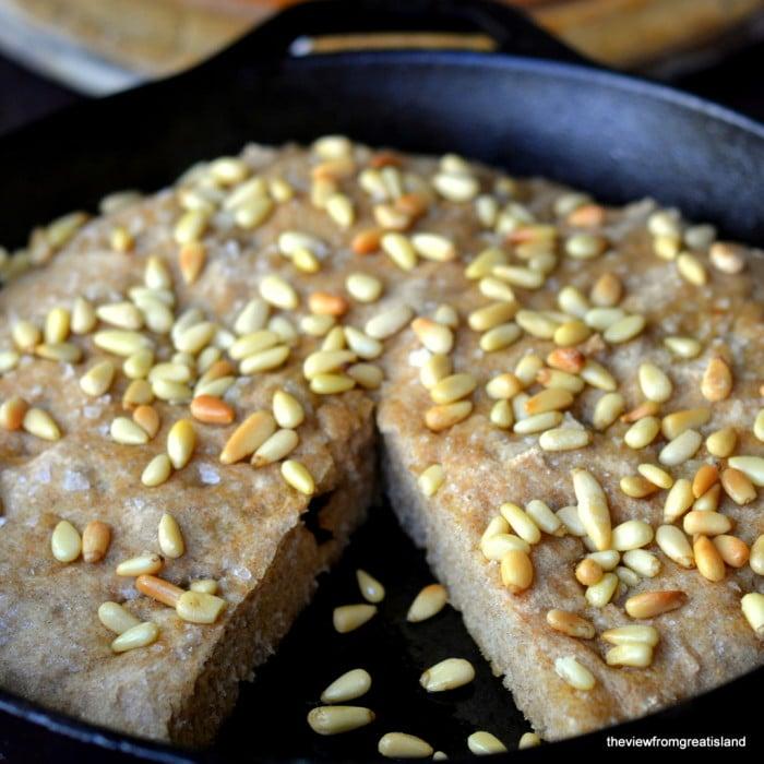whole wheat focaccia bread in a cast iron skillet