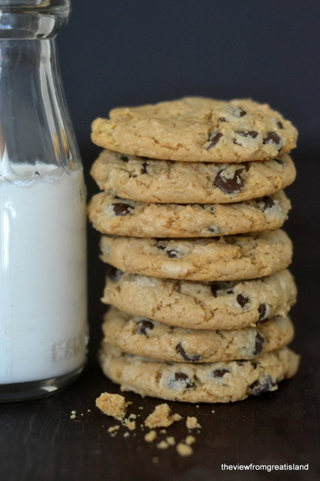 flourless cashew butter chocolate chip cookies in a stack with milk bottle