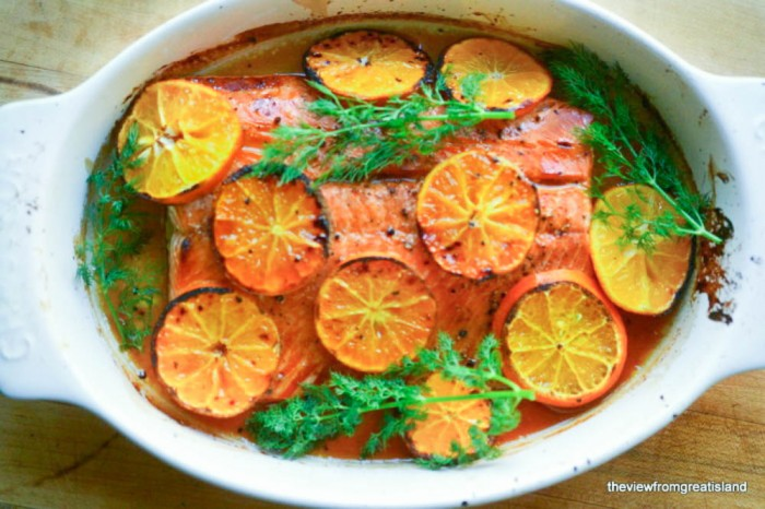 vodka and clementine glazed salmon in a baking dish