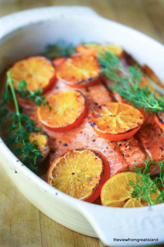salmon with clementines in a white baking dish