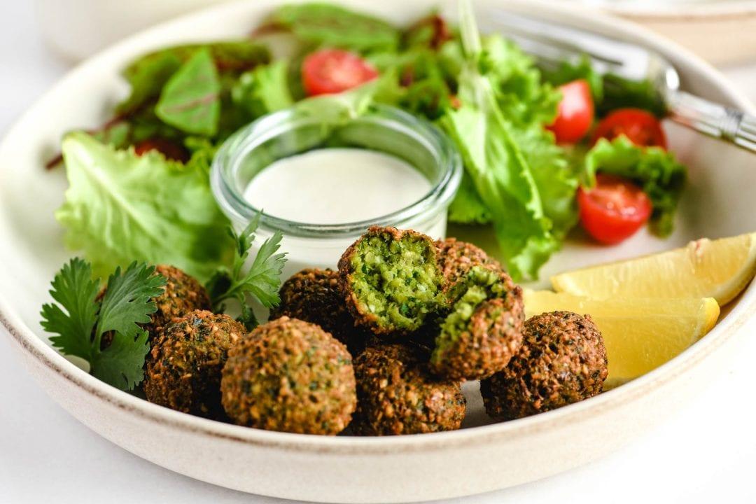 serving falafel with tahini sauce