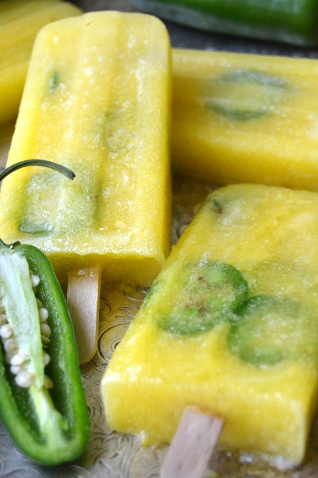 Photograph of pineapple jalapeno popsicles laying on a tray.