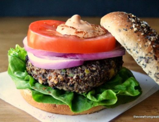 Red Quinoa and Black Bean Veggie Burger on a wooden board