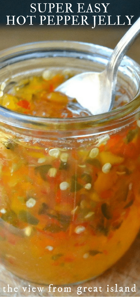 Super Easy Hot Pepper Jelly is a must in every cook's arsenal.  This easy recipe makes use of both sweet and hot peppers for a colorful, confetti-like look and and an intense spicy kick. #jelly #jam #hotpeppers #cheeseplate #recipe #jalapenorecipe #jalapeno #appetizer #cheeseandcrackers #FOODGIFT #THANKSGIVINGAPPETIZER #HOLIDAYAPPETIZER