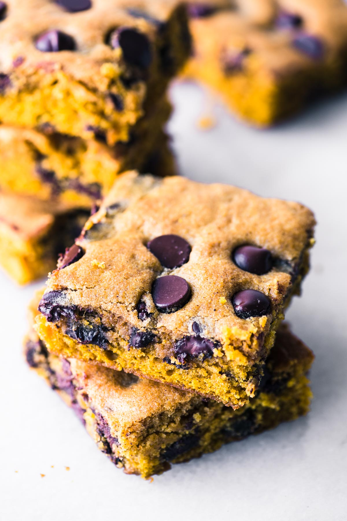 a stack of pumpkin chocolate chip blondies