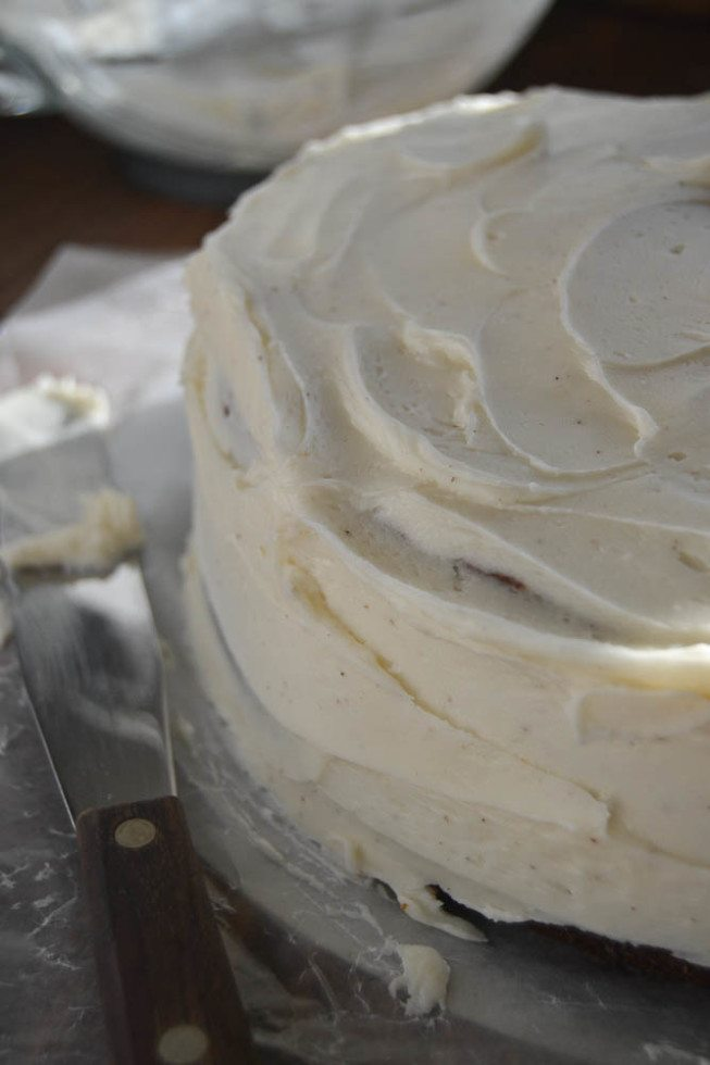 Photo of Banana Cake with Spiced Vanilla Buttercream being frosted.