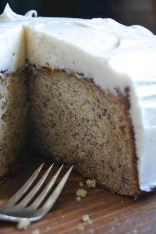 Photo of Banana Cake with Spiced Vanilla Buttercream with slice taken out of it.