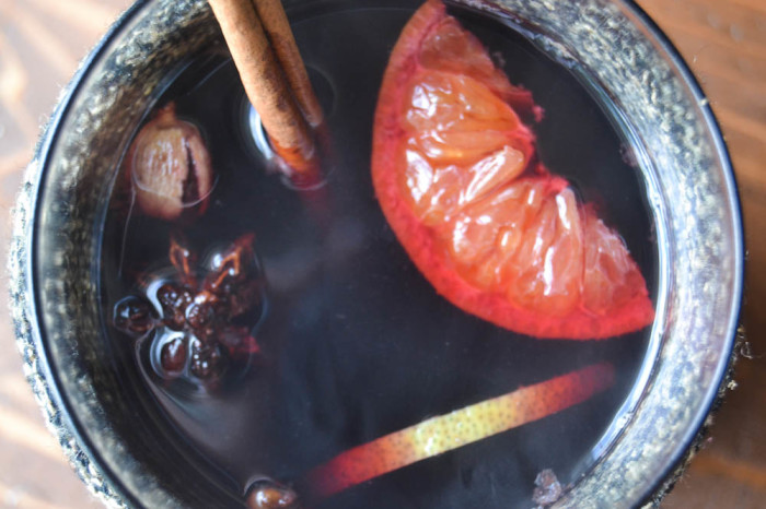 A steaming cup of spiced mulled wine