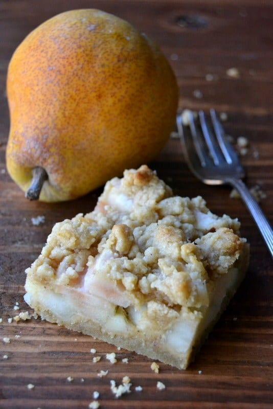 A spiced pear crumble bar with fresh pear and fork