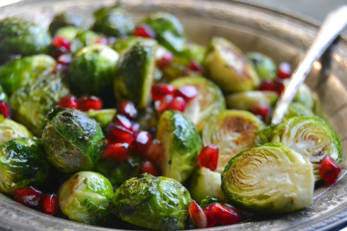 Oven Roasted Brussels Sprouts garnished with pomegranate seeds