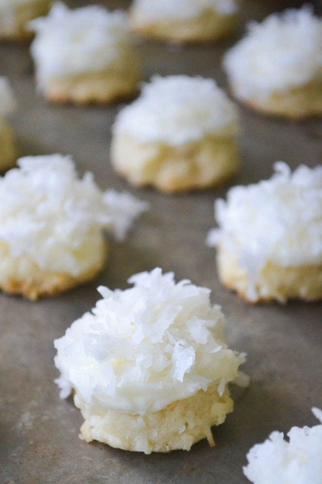 Photo of coconut snowball melting moments on a baking sheet.