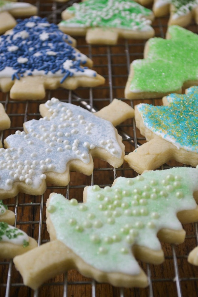 decorated sugar cookies cooling on a rack