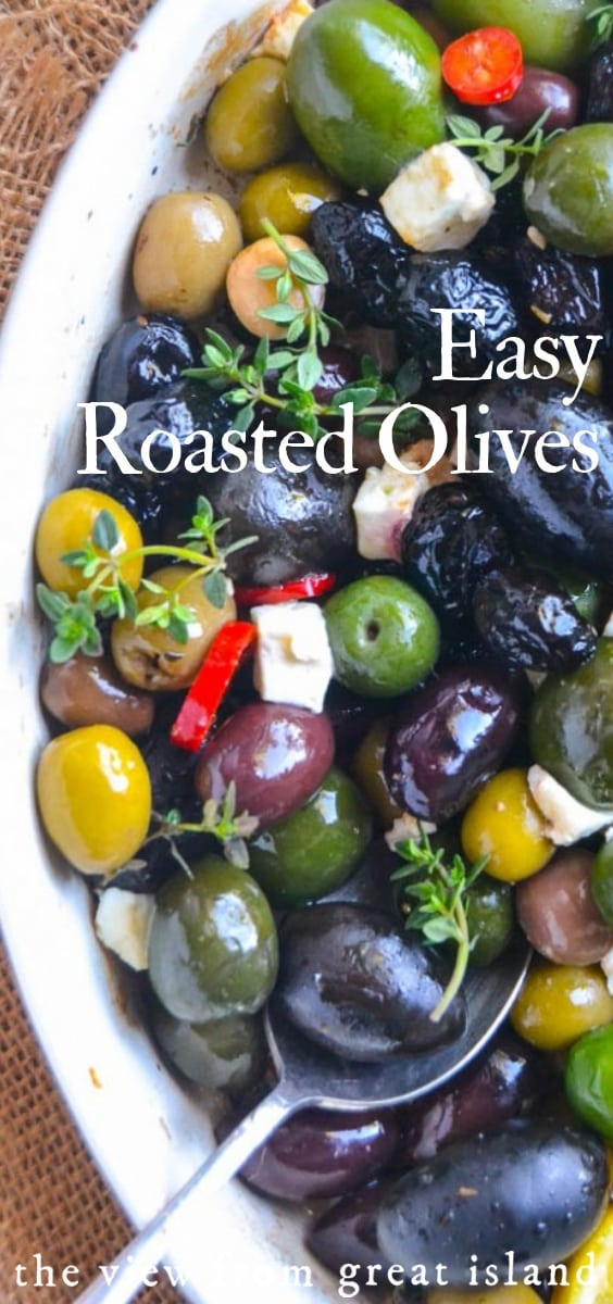 Easy Roasted Olives ~ this simple and elegant Mediterranean inspired appetizer is my go to for parties of all kinds.  Healthy olives fit into most everyone's diet, so it's always a hit. #appetizer #olives #mediterranean #healthy #vegan #glutenfree #easy #recipe #marinated #black #green