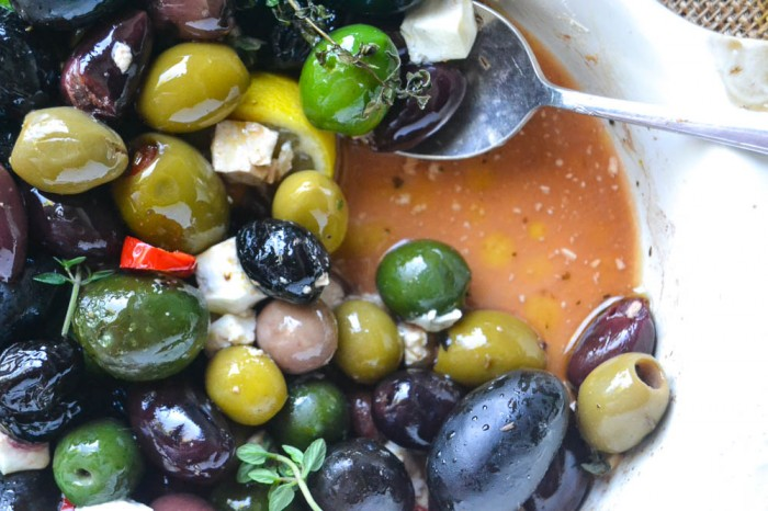 Serve roasted olives and feta with cocktails for an easy relaxed affair.