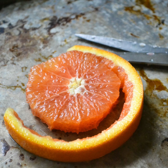 slicing cara cara oranges for citrus caprese salad