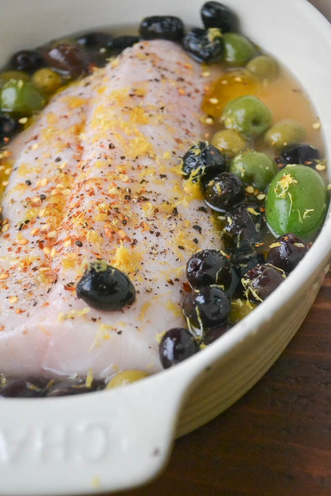 baked cod with lemon and olives ready for the oven