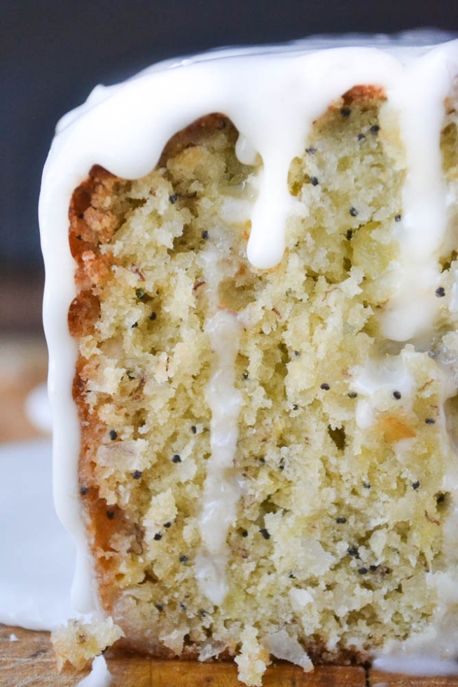 Glazed Pineapple Banana Bread with glaze dripping