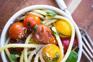 bucatini pasta with burst tomatoes and basil