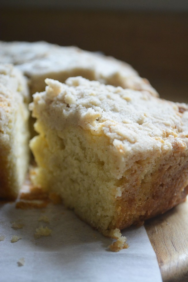 moist buttery cardamom crumb cake, sliced