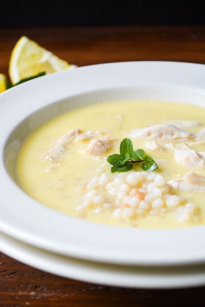 Lemon soup with chicken and couscous in a white bowl