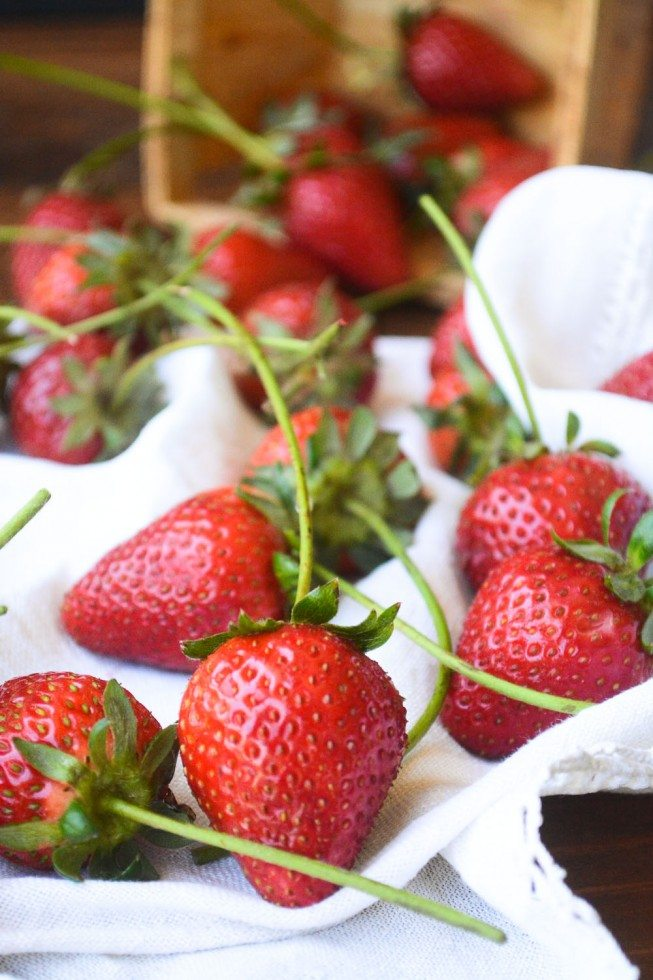 Photo of strawberries on a white cloth for easy chocolate dipped strawberries.