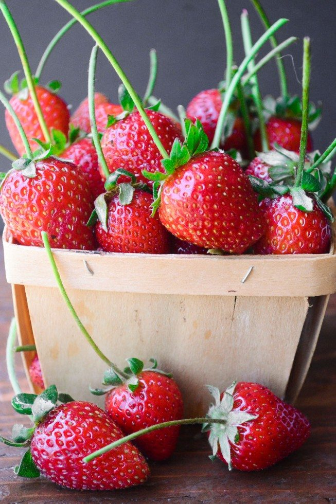 Photo of a basket of strawberries for easy chocolate dipped strawberries.