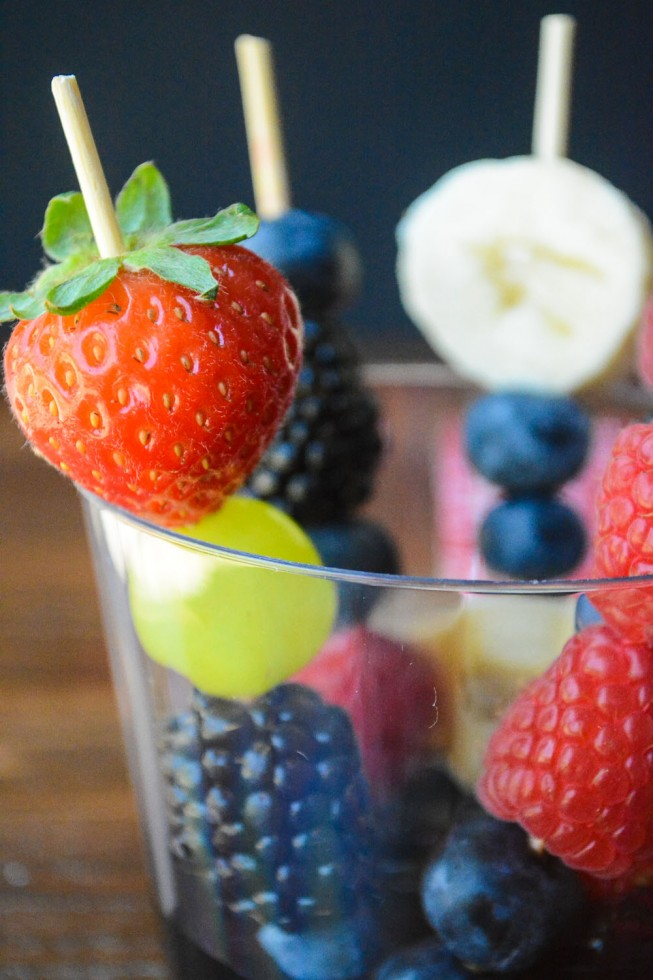 individual chocolate fondue cups with fruit skewers