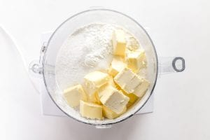 cutting butter into flour for strawberry scones