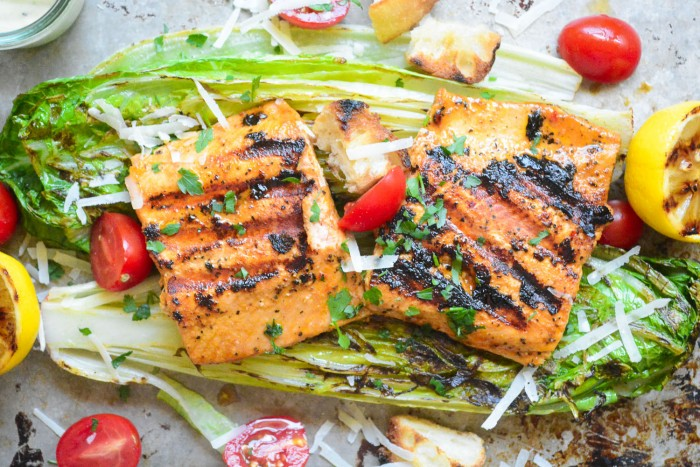 Juicy salmon on grilled romaine lettuce