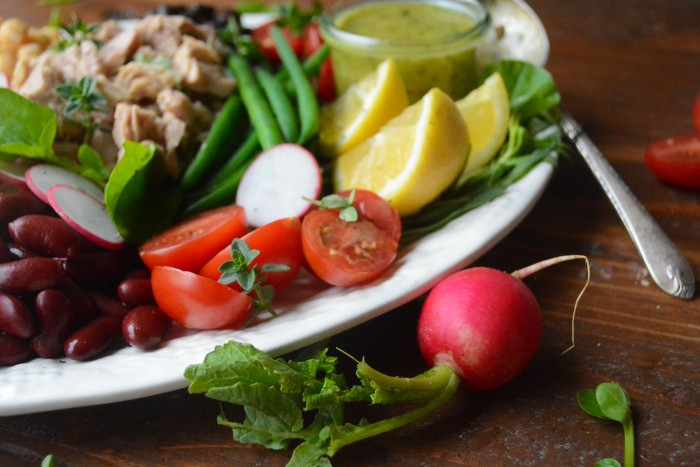 an easy elegant summer meal of olive oil packed tuna and beans with a tarragon vinaigrette