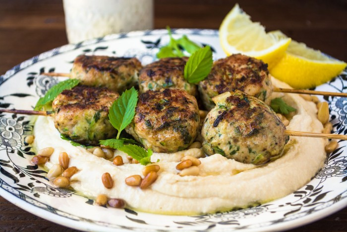 Creamy hummus with turkey and zucchini meatball skewers