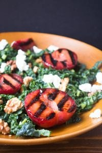 Grilled plumcot and kale salad with toasted walnut vinaigrette