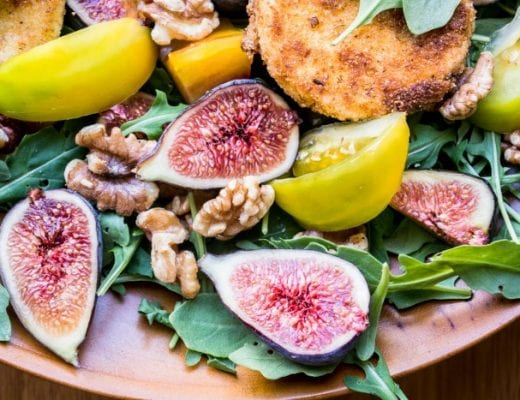 healthy summer salad of arugula, figs, and fried goat cheese