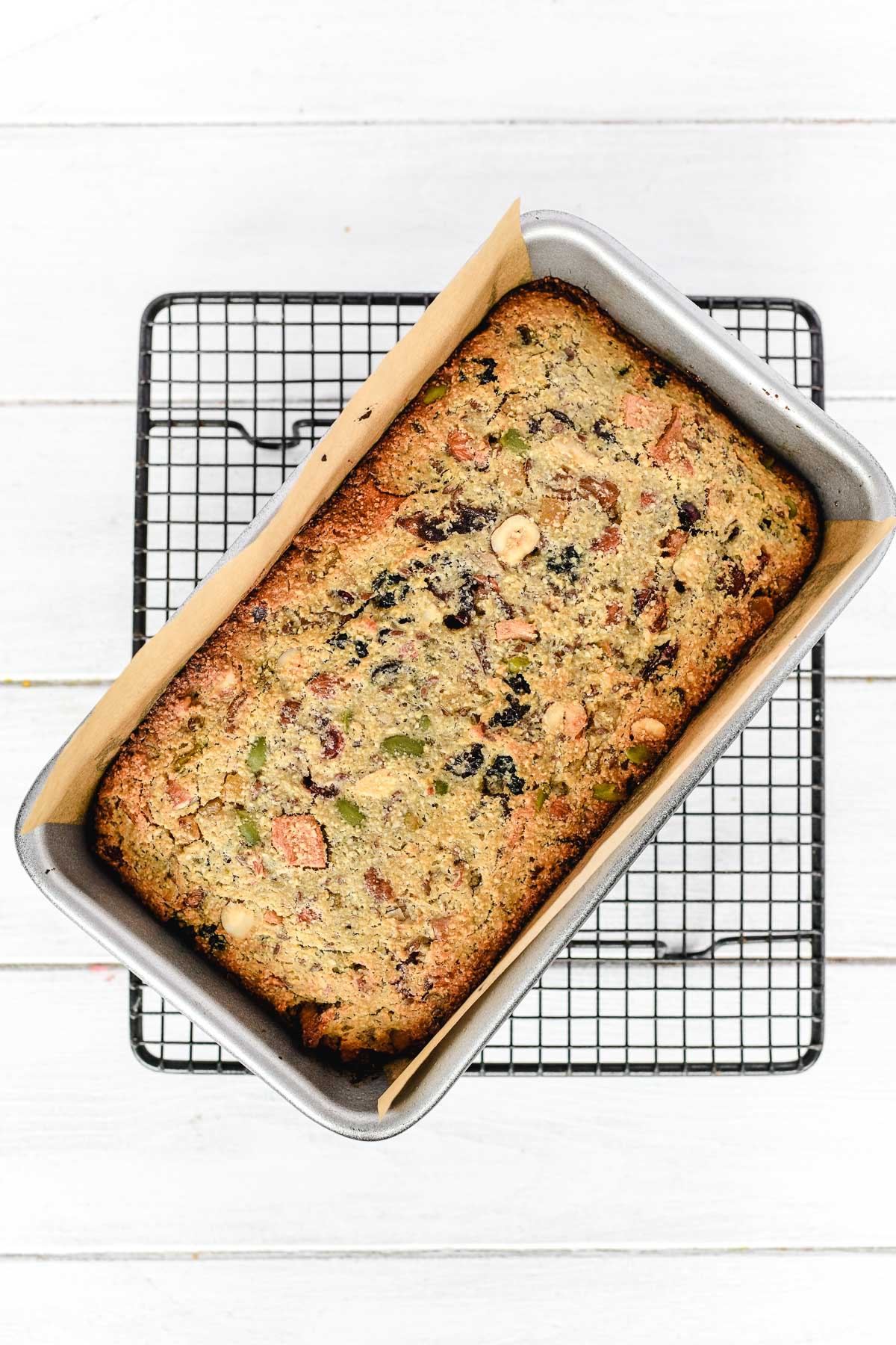 paleo fruit and nut bread on a cooling rack