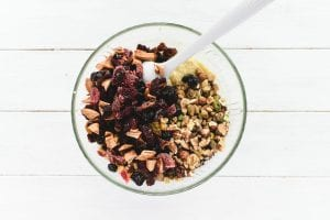 Folding dried fruit and nuts into paleo bread batter