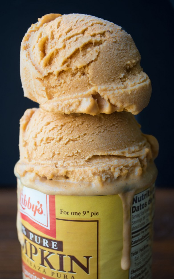 Two scoops of Pumpkin Pie Ice Cream on top of a can of pumpkin.
