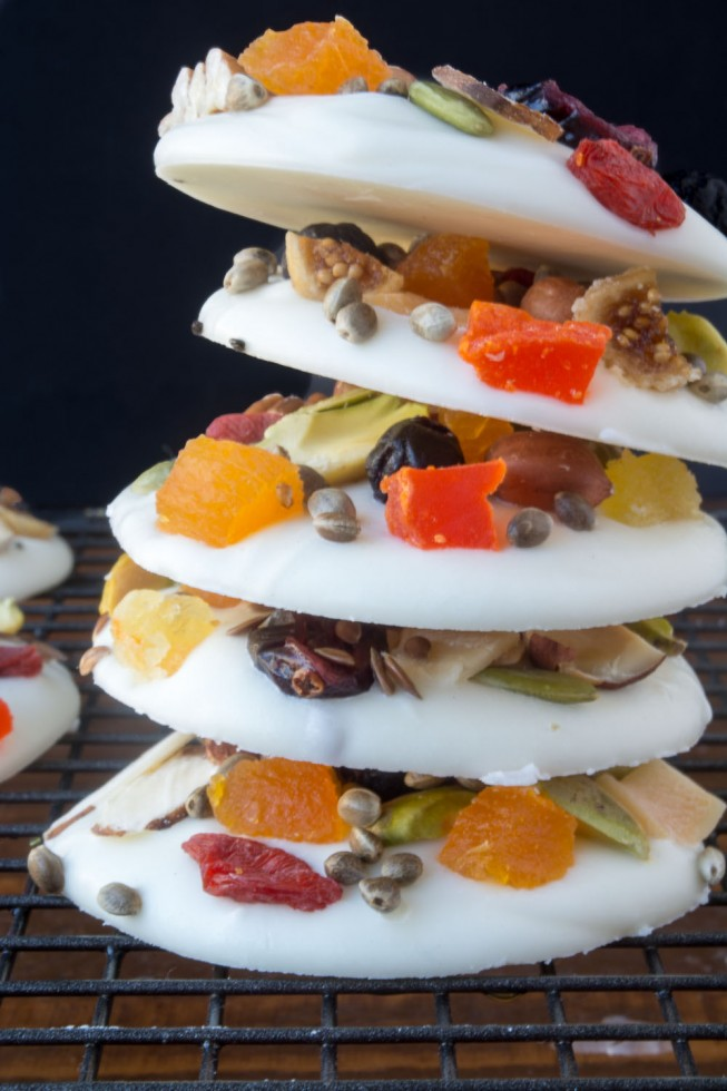 White Chocolate Energy Bites are little medallions of white confectionary topped with fruit, nuts, and seeds
