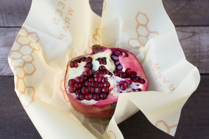 Pomegranate wrapped in Bee's Wrap --- reuseable food wrap that's healthy, sustainable, and fun to use!