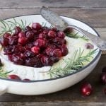 Sweet, tangy, and buttery Baked Brie with Roasted Maple Cranberries makes a perfect holiday appetizer