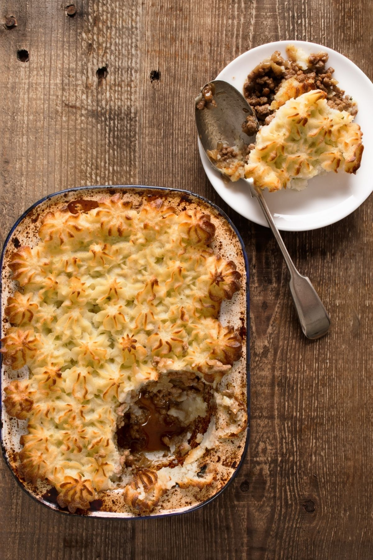 serving farmhouse shepherd's pie onto a small plate