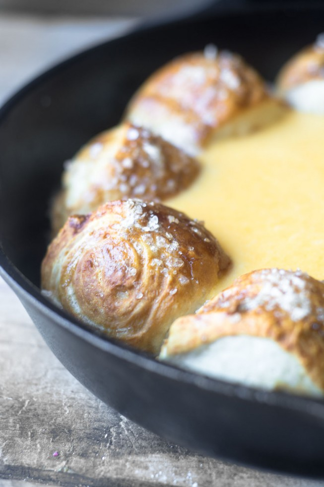 A people pleasing game night appetizer - Cheesy Beer Dip with Pretzel Rolls