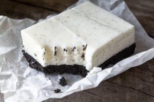 No Bake Vanilla Bean Cheesecake Squares with a deep dark chocolate cookie crust