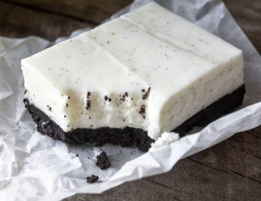No Bake Vanilla Bean Cheesecake Squares with a deep dark chocolate cookie crust