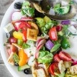 Healthy and colorful Fattoush Salad is a Middle Eastern masterpiece of fresh veggies, and toasted pita, in a tangy lemon dressing