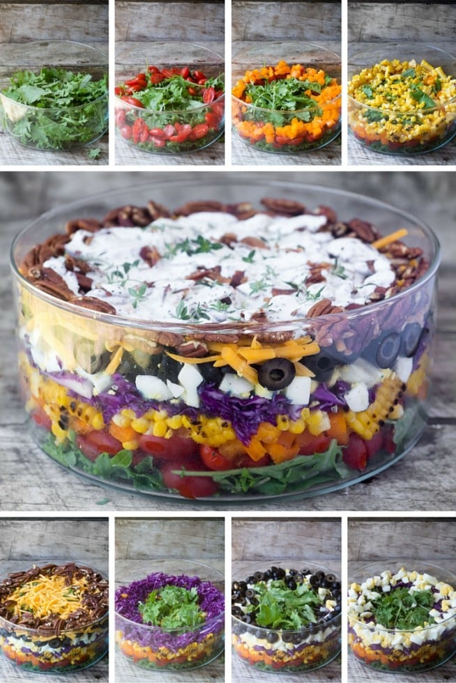 A pretty Layered Rainbow Salad topped with crunchy toasted pecans and bacon, drenched in a tangy buttermilk poppy seed dressing.