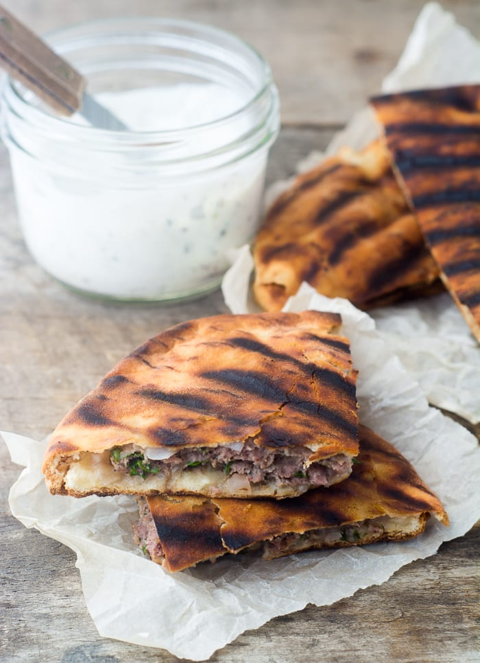 Spiced Lamb Pita Burgers are a fun twist on everybody's favorite grill grub! theviewfromgreatisland.com