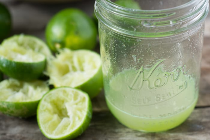 Squeezing limes for Tangy Lime Squares recipe | theviewfromgreatisland.com