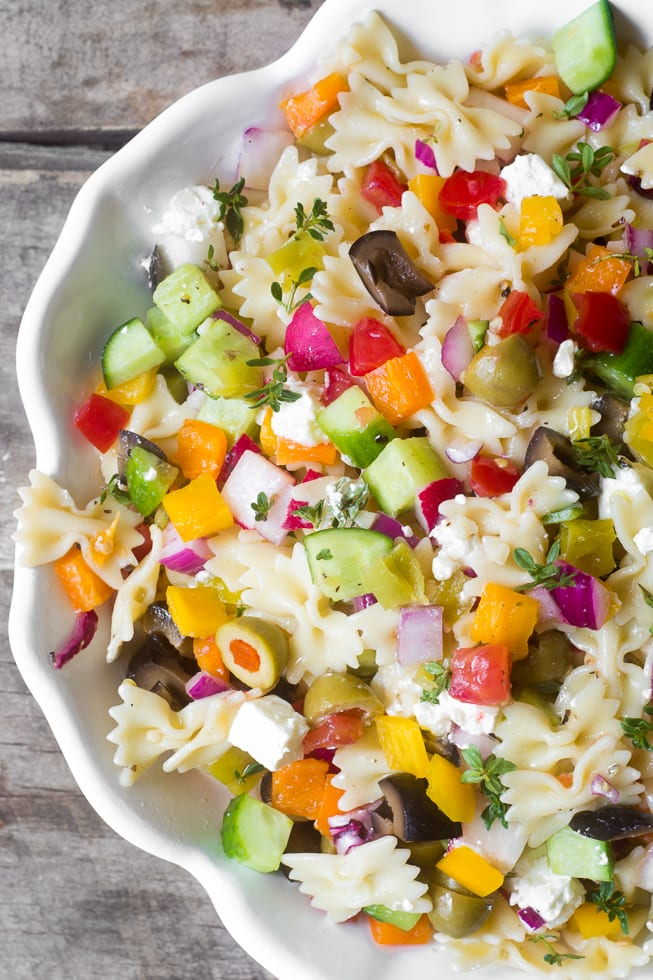 Chopped Israeli Pasta Salad is a healthy, veggie packed variation on your favorite summer salad, it keeps super well, in fact I think it's better after a day or two in the fridge! | theviewfromgreatisland.com