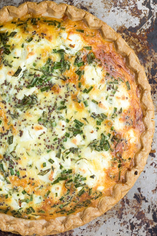 Sweet Onion and Herb Quiche on a baking sheet