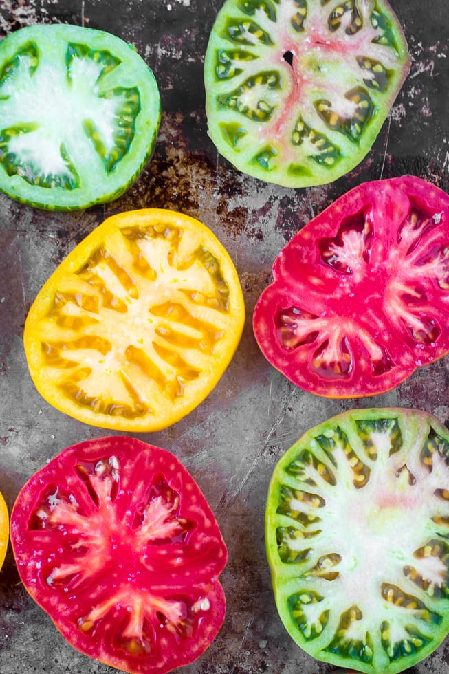 Slicing heirloom tomatoes for Heirloom Tomatoes Parmesan | theviewfromgreatisland.com